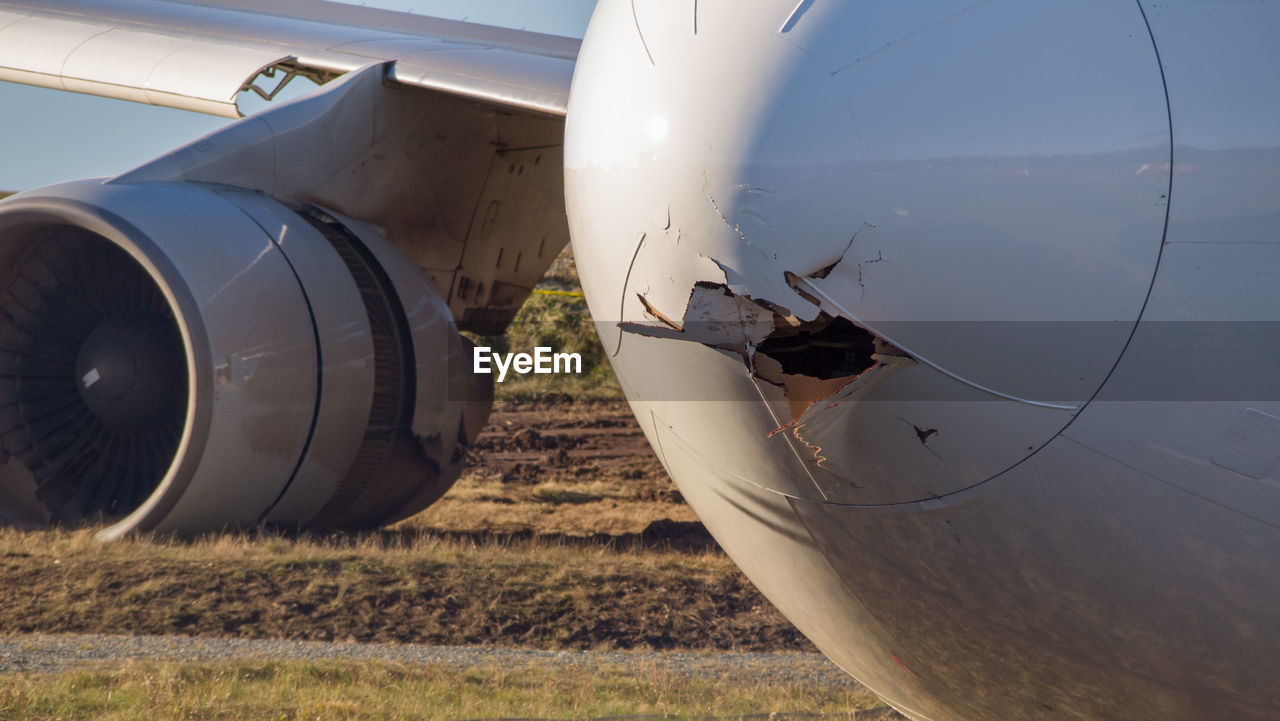 Close-up of crashed airplane on runway