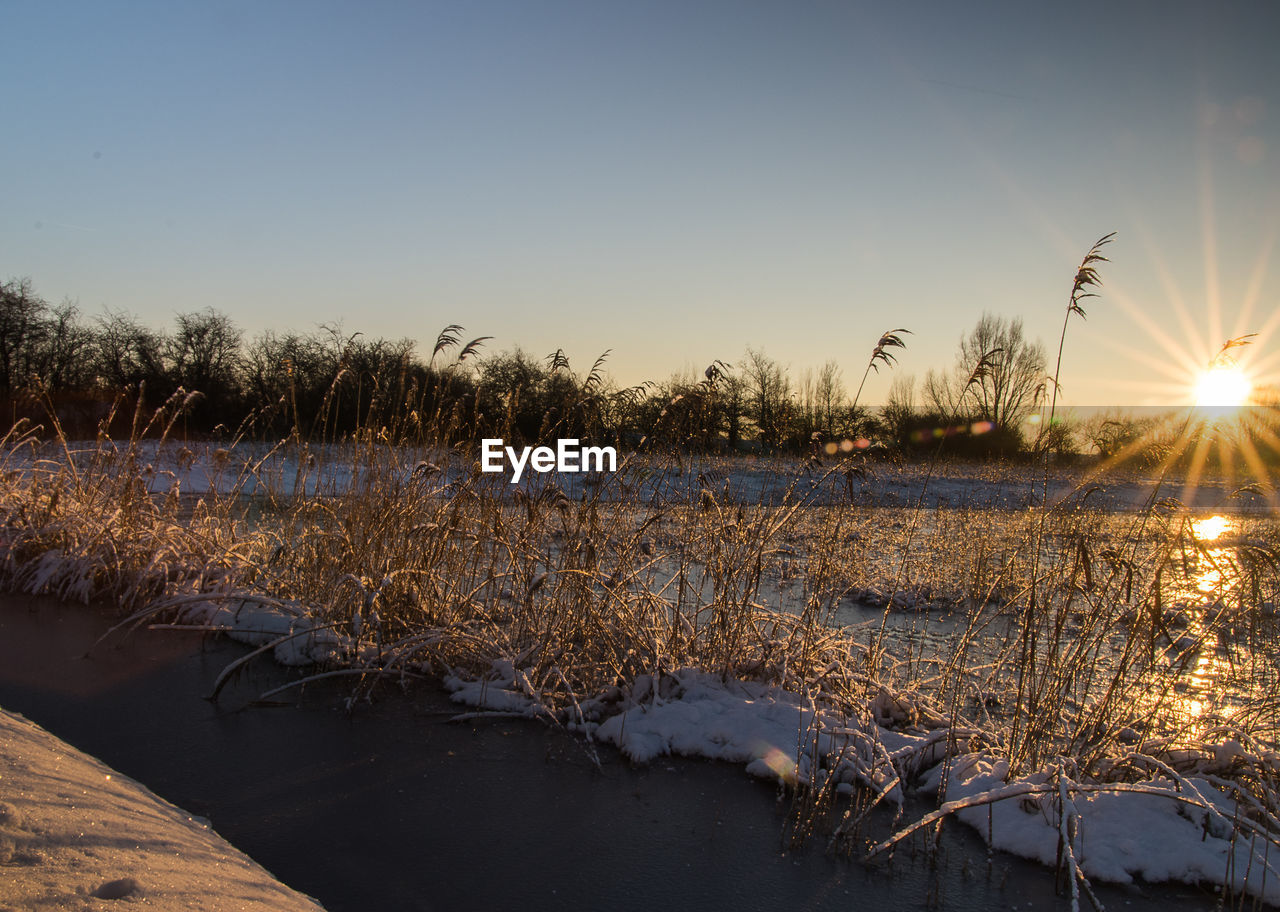Sunbeam Falling On River At Sunset During Winter