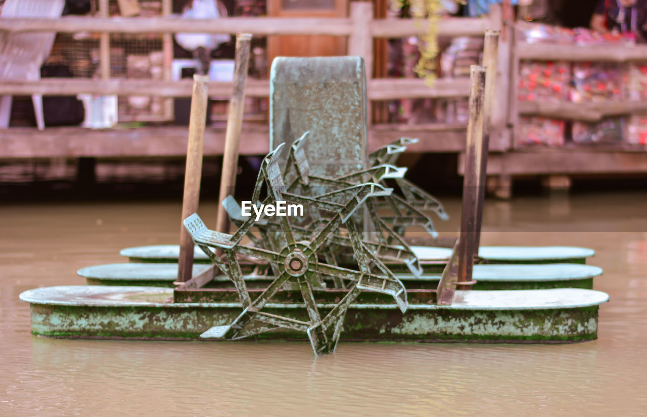 no people, indoors, focus on foreground, still life, table, stack, wood - material, large group of objects, day, close-up, metal, selective focus, art and craft, flooring, creativity, abundance, tied up, rope