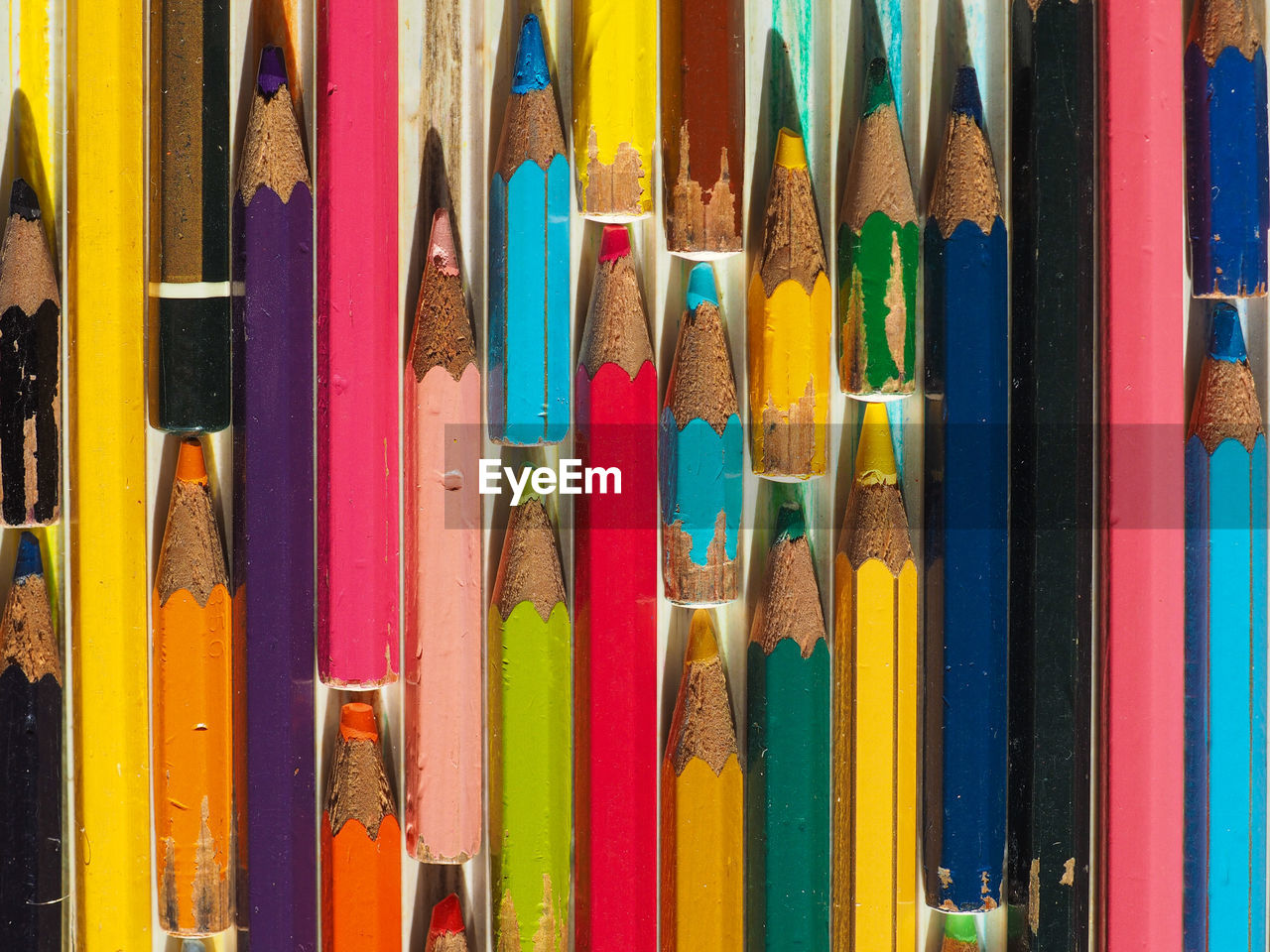multi colored, choice, variation, no people, pencil, large group of objects, close-up, full frame, collection, still life, art and craft, wood - material, indoors, arrangement, creativity, for sale, in a row, pattern, backgrounds, retail, colored pencil, art and craft equipment, variety
