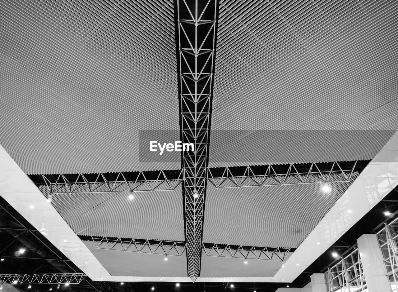 built structure, architecture, low angle view, ceiling, illuminated, indoors, lighting equipment, no people, pattern, modern, night, recessed light, metal, design, light, building, shopping mall, architectural feature, railing, light fixture