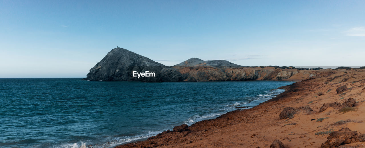 sky, sea, scenics - nature, water, beauty in nature, tranquil scene, tranquility, land, non-urban scene, nature, beach, mountain, rock, no people, blue, idyllic, horizon, horizon over water, rock - object, outdoors