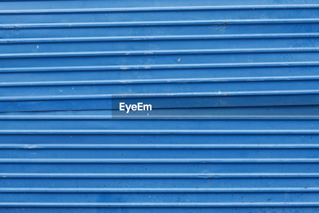Full frame shot of closed blue shutter