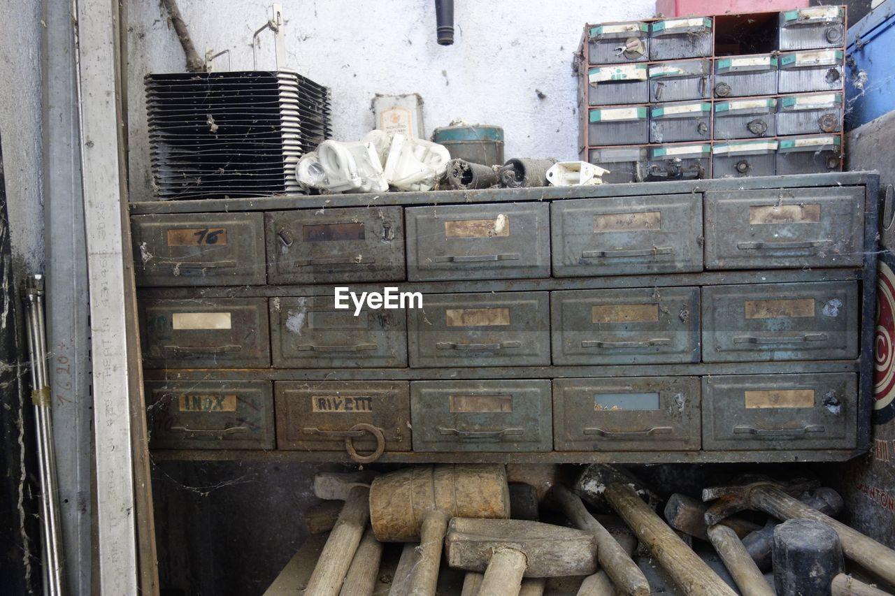 Various hammers below drawers at workshop