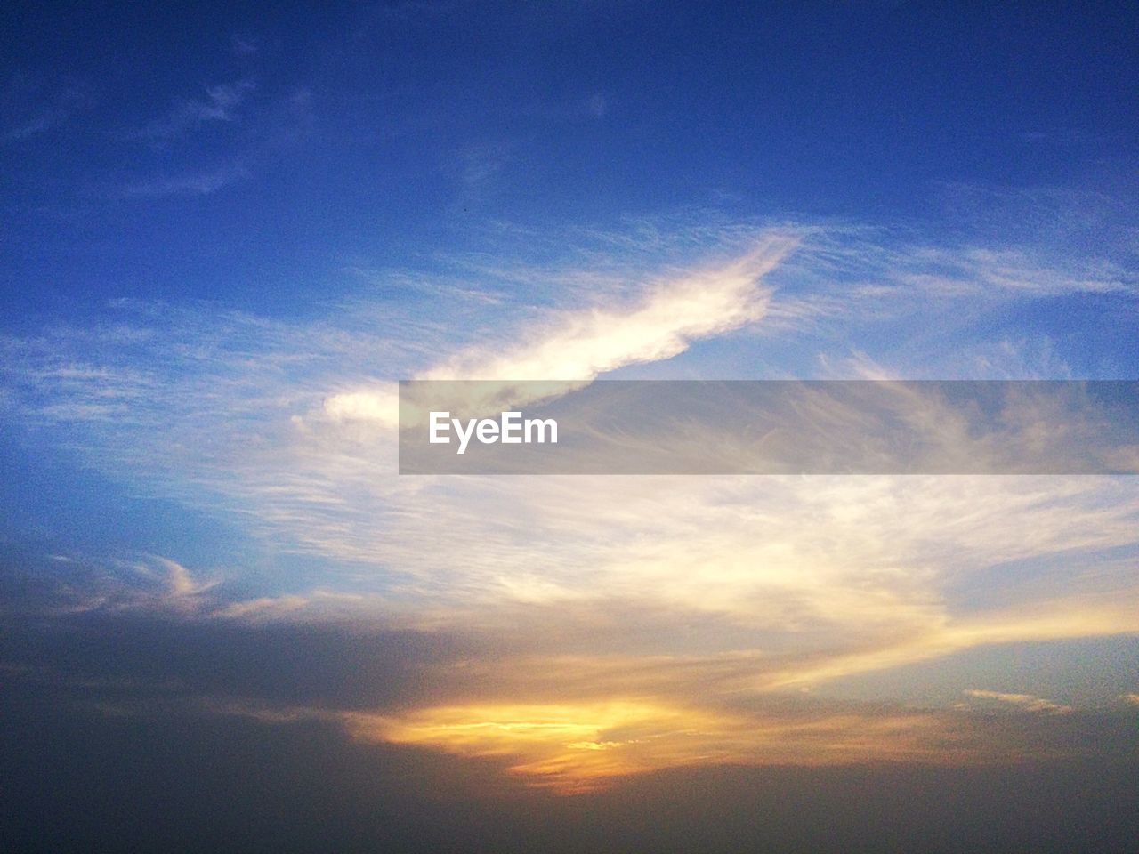 Scenic view of cloudscape at sunset