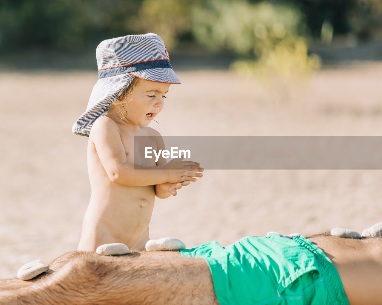 childhood, focus on foreground, child, day, males, land, shirtless, real people, boys, three quarter length, leisure activity, men, side view, clothing, summer, looking, nature, water, beach, outdoors, innocence