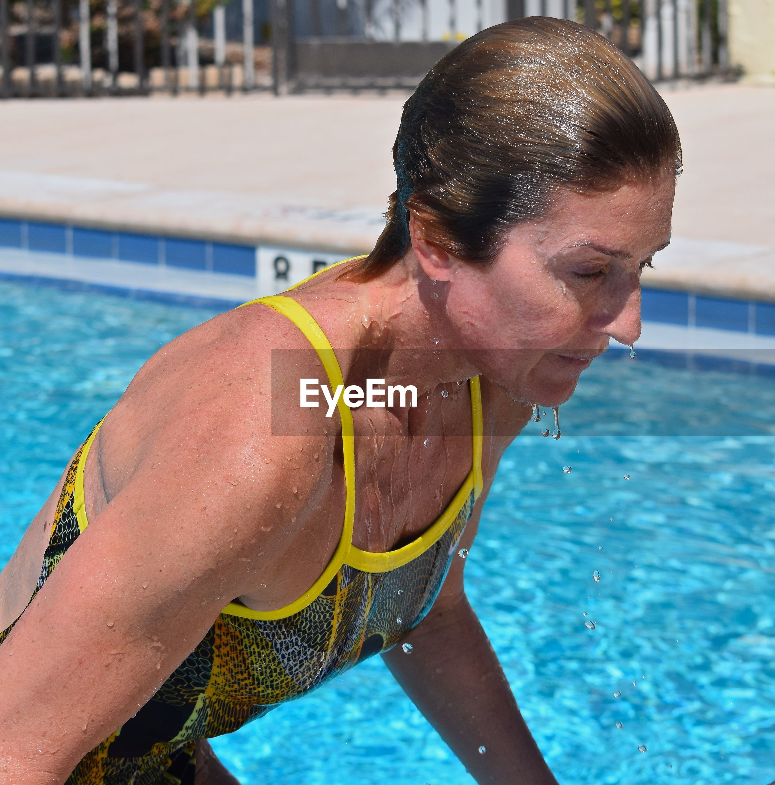 Close-up of female athlete coming out from swimming pool
