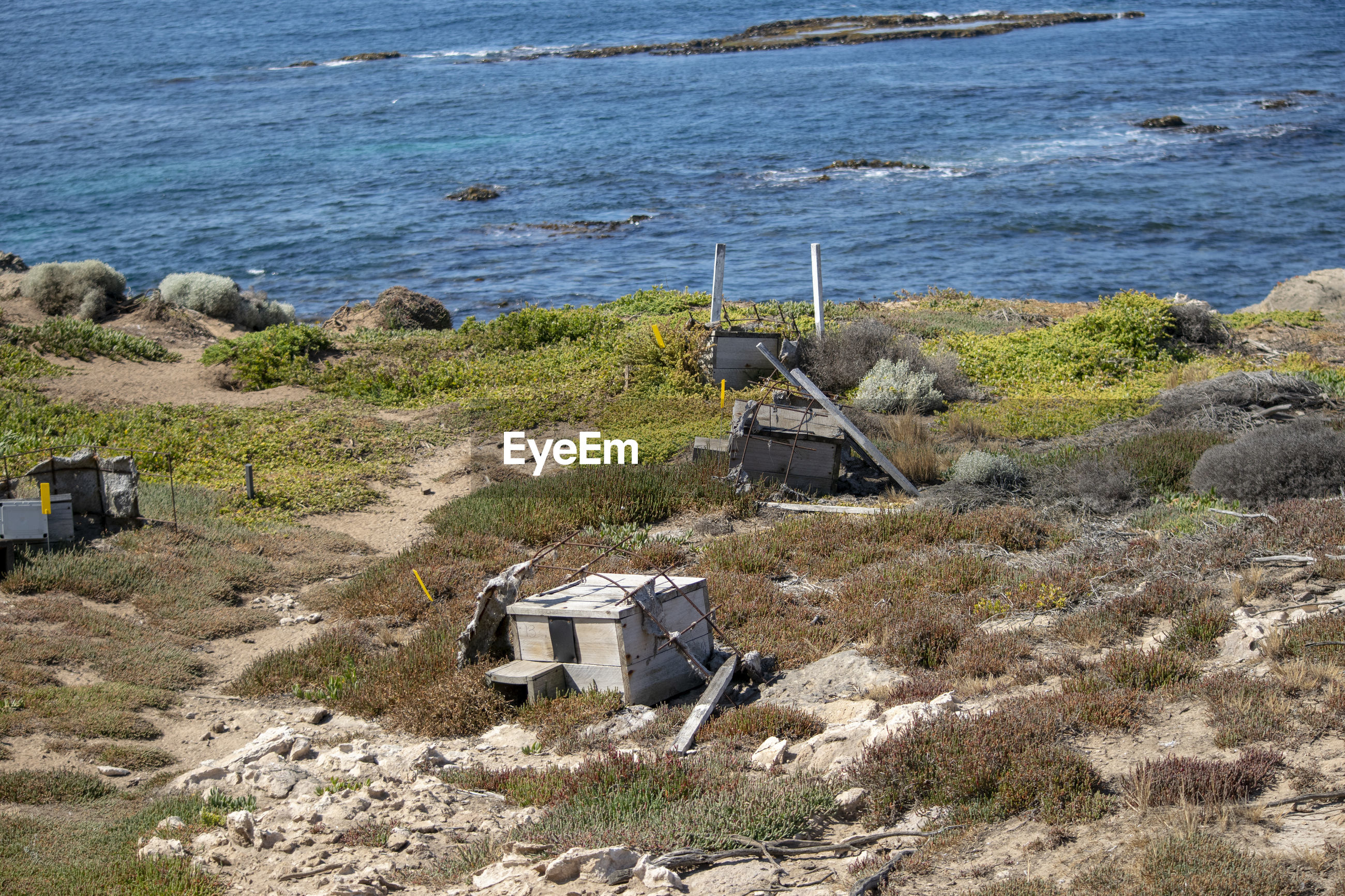 HIGH ANGLE VIEW OF ABANDONED BUILDING ON BEACH