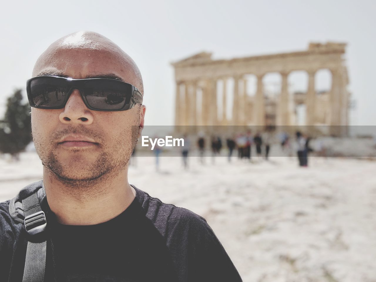 Portrait Of Man Wearing Sunglasses Against Acropolis