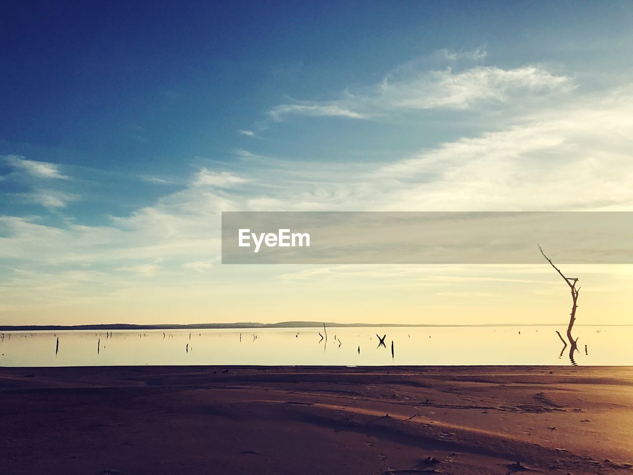 sky, cloud - sky, scenics - nature, nature, tranquil scene, beauty in nature, tranquility, environment, land, no people, sunset, outdoors, wind turbine, landscape, turbine, fuel and power generation, transportation, non-urban scene, beach, connection