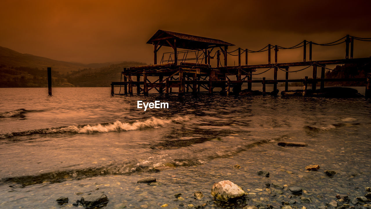 water, sky, sunset, sea, built structure, architecture, beach, land, nature, beauty in nature, no people, pier, scenics - nature, orange color, cloud - sky, wave, tranquility, tranquil scene, outdoors
