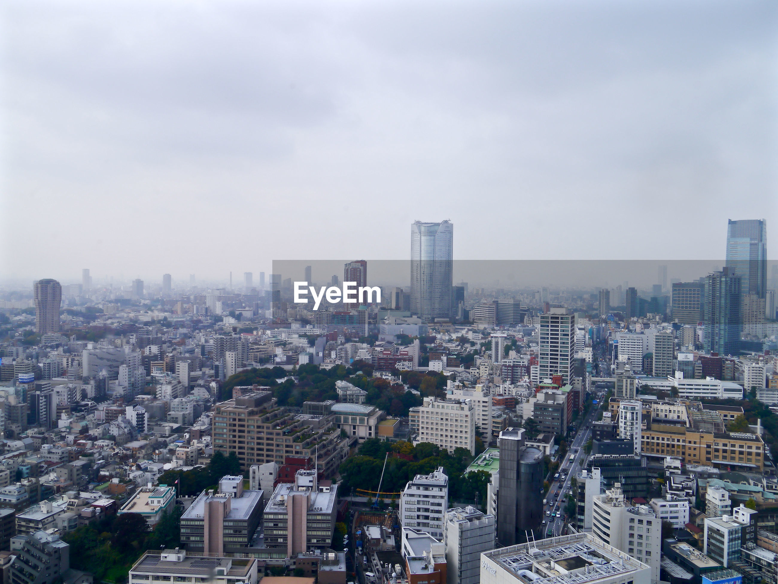 city, cityscape, building exterior, architecture, built structure, skyscraper, crowded, tall - high, sky, tower, high angle view, office building, modern, residential district, city life, residential building, capital cities, urban skyline, cloud - sky, tall