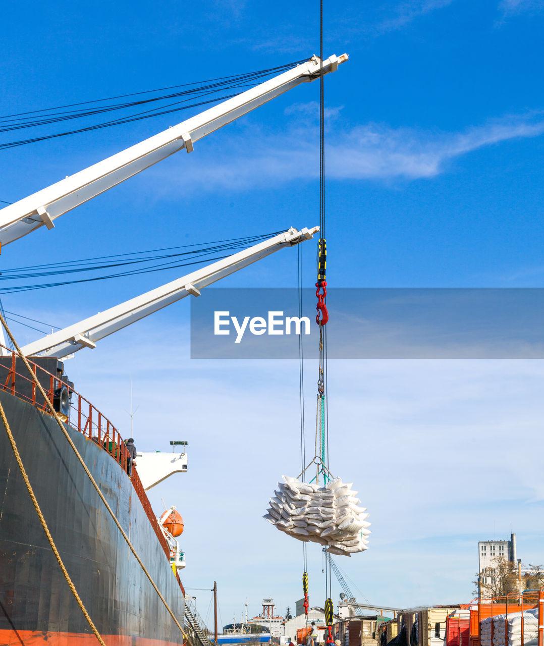 Loading tons of grain onto large overseas ship