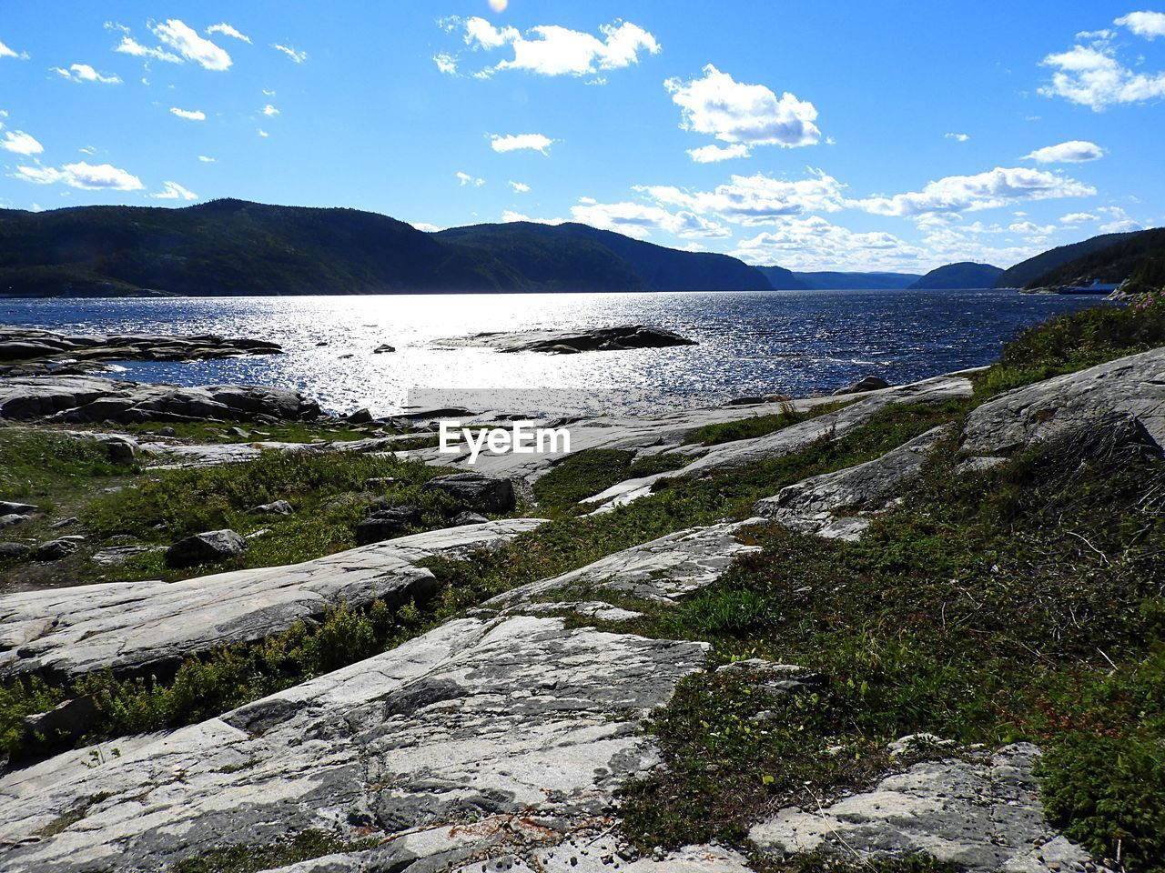 sky, water, beauty in nature, scenics - nature, mountain, cloud - sky, tranquility, tranquil scene, sea, nature, no people, rock, day, land, non-urban scene, solid, rock - object, beach, idyllic, outdoors, flowing water, rocky coastline