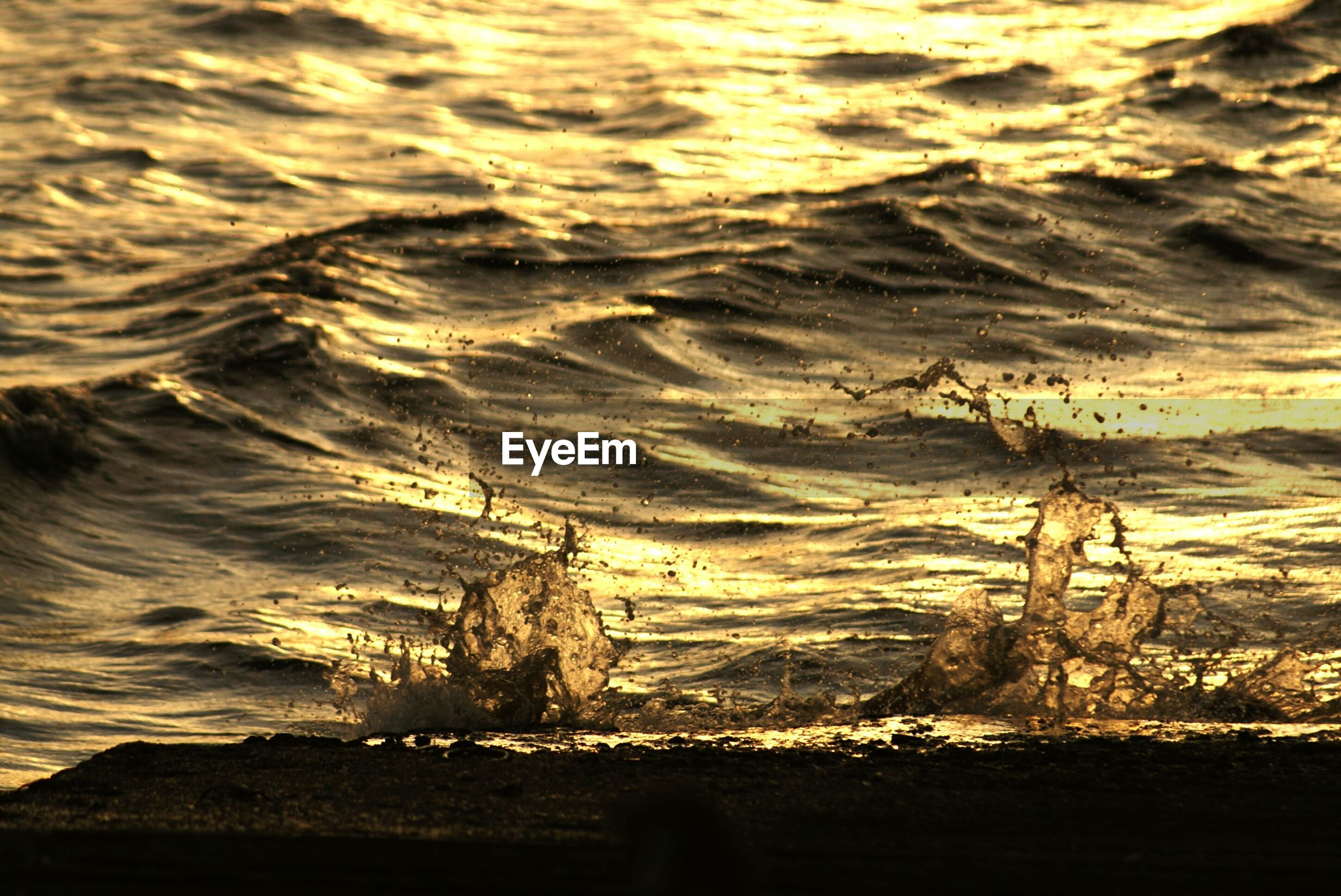 High angle view of sea at sunset