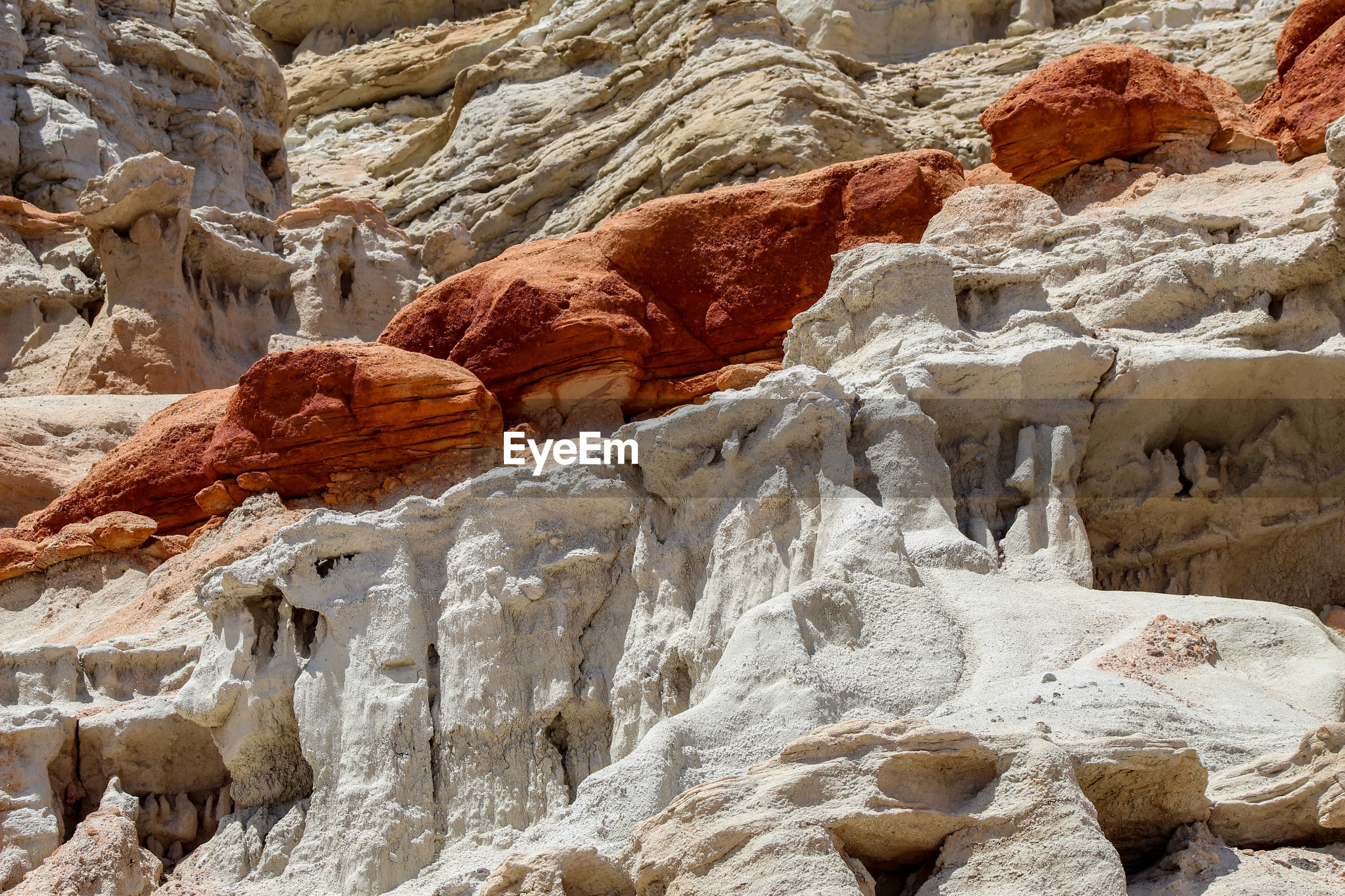 LOW ANGLE VIEW OF ROCKS ON ROCK FORMATIONS
