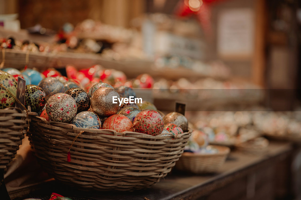 Close-Up Of Colorful Easter Eggs In Wicker Baskets For Sale In Store