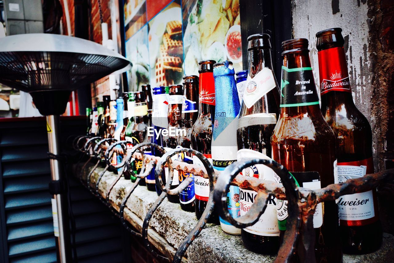 no people, choice, large group of objects, day, drink, variation, architecture, multi colored, retail, still life, container, bottle, outdoors, city, built structure, building exterior, refreshment, food and drink, collection, arrangement