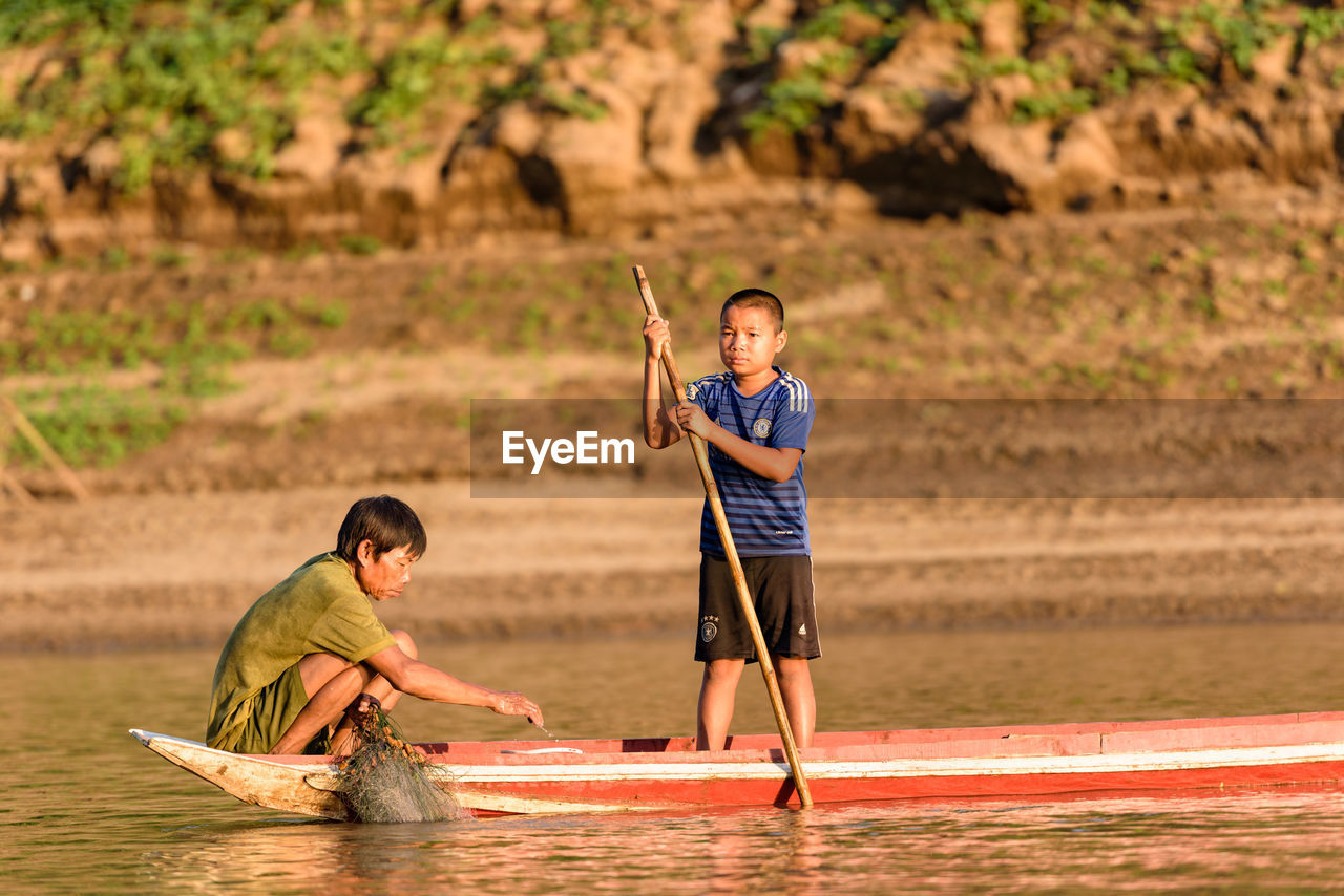 two people, real people, leisure activity, boys, men, water, outdoors, sport, oar, togetherness, day, nature, adult, people