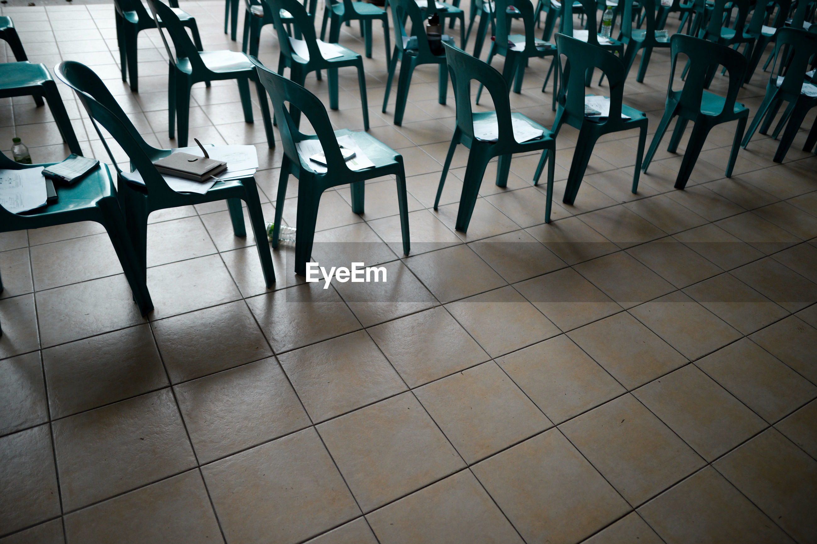 EMPTY CHAIRS AND TABLE IN ROW