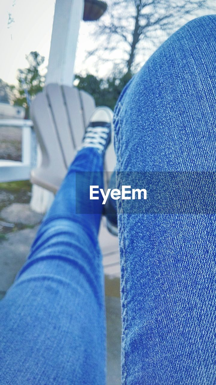 jeans, human leg, personal perspective, low section, human body part, shoe, blue, one person, casual clothing, real people, day, leisure activity, close-up, lifestyles, outdoors, men, nature, human hand, people
