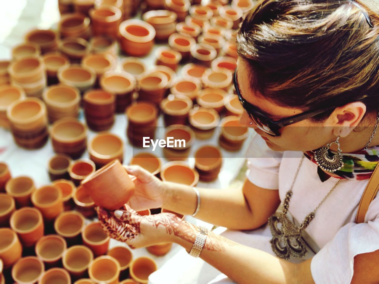 High Angle View Of Woman Holding Earthenware