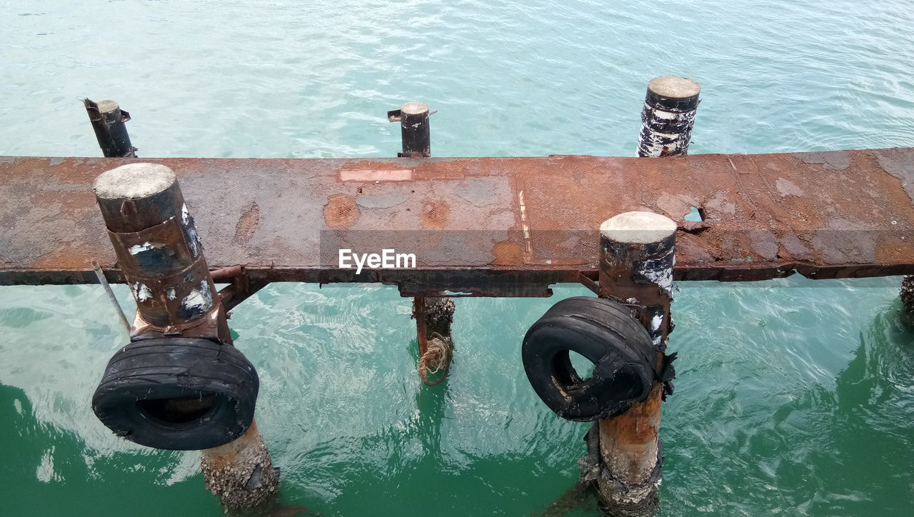 water, transportation, day, sea, nautical vessel, nature, metal, mode of transportation, rusty, high angle view, outdoors, no people, waterfront, rope, moored, wood - material, turquoise colored