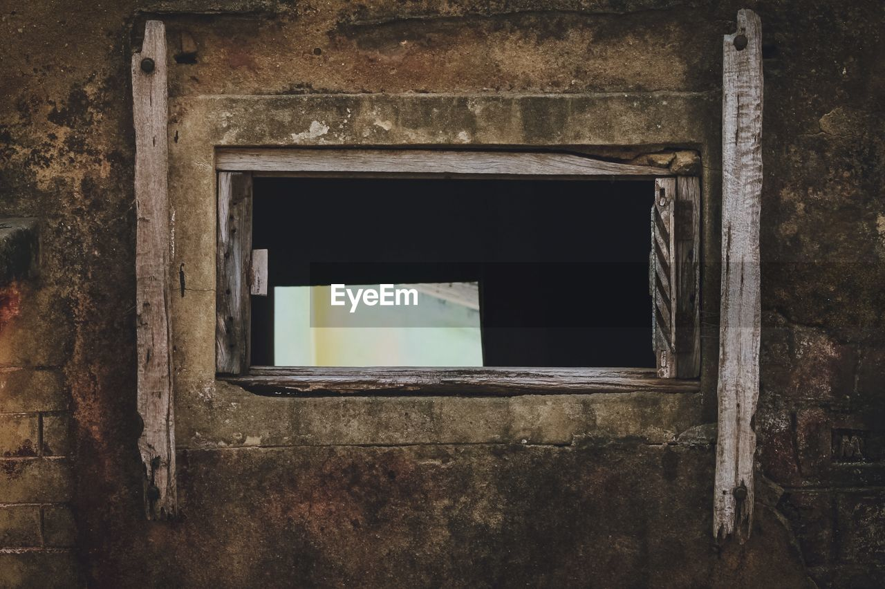 Old window having shutter broken of an abandoned building
