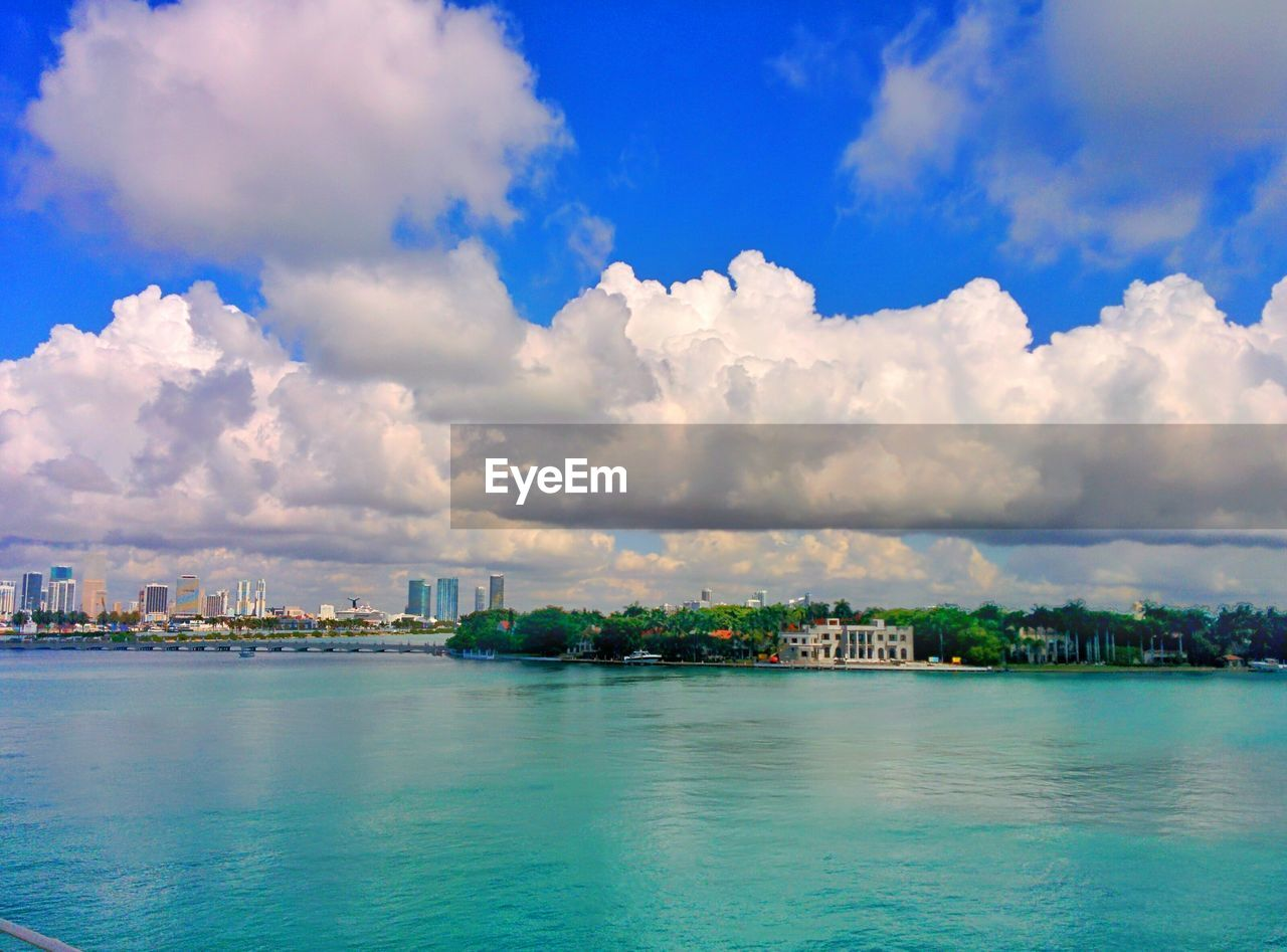 sky, cloud - sky, architecture, building exterior, built structure, water, city, outdoors, no people, cityscape, waterfront, beauty in nature, sea, scenics, nature, day, blue, travel destinations