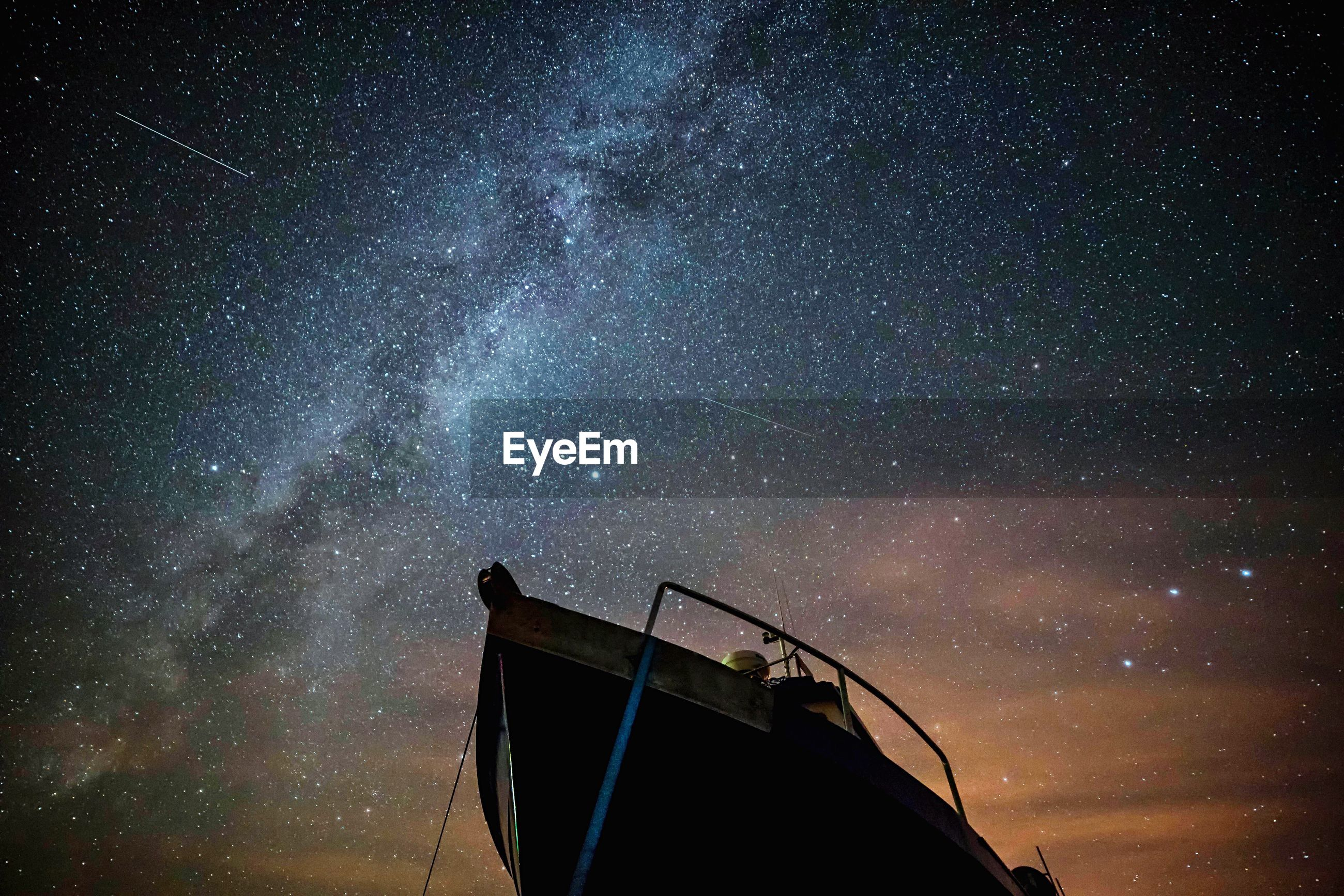 Low angle view of boat against starry sky at night