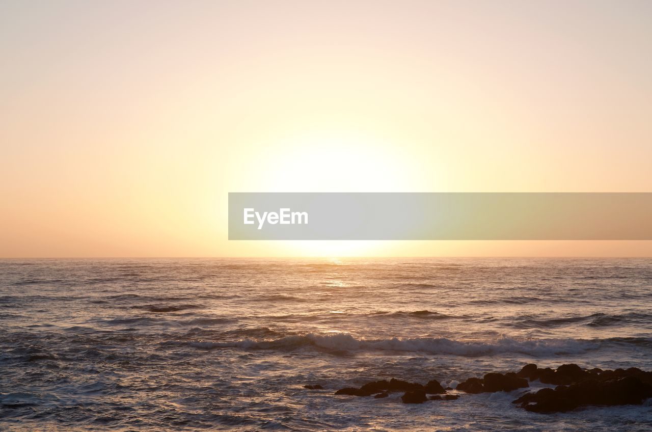 sea, sky, water, horizon over water, horizon, beauty in nature, sunset, scenics - nature, nature, clear sky, sun, wave, tranquility, tranquil scene, no people, idyllic, waterfront, outdoors, motion