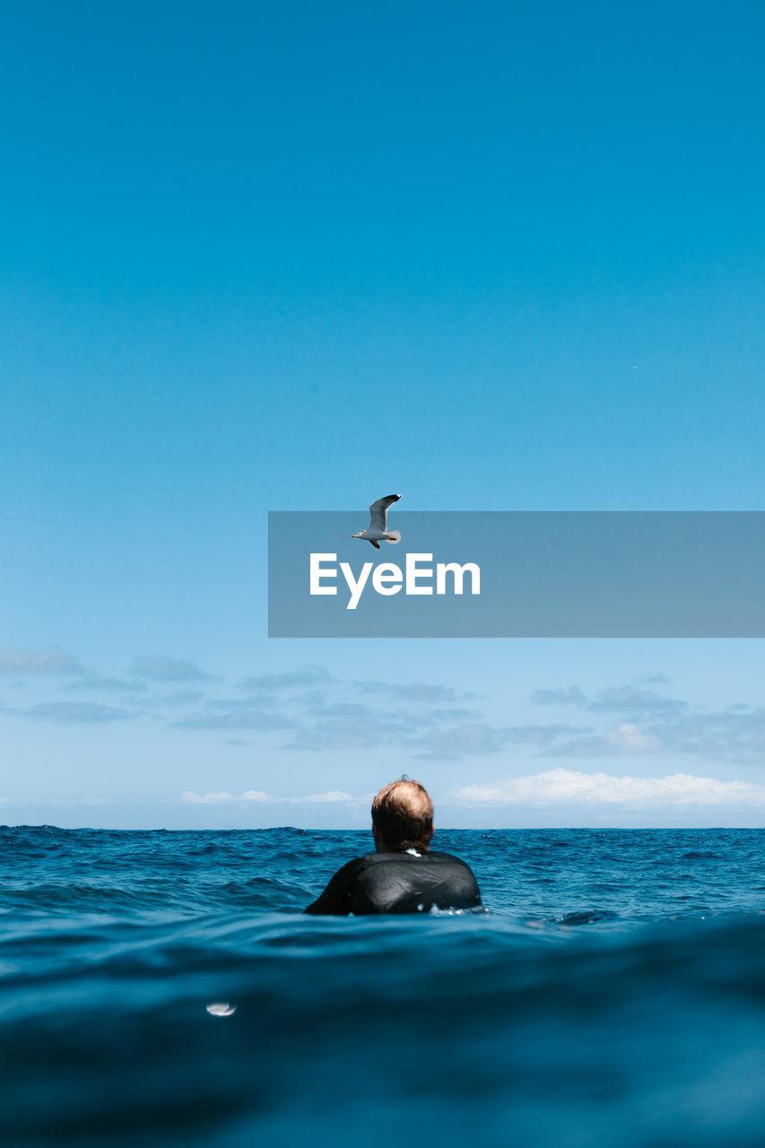 MAN SWIMMING IN A SEA