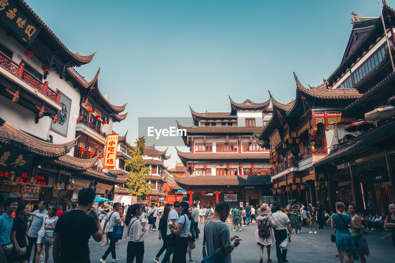 architecture, built structure, building exterior, large group of people, crowd, group of people, real people, sky, building, city, nature, men, women, travel destinations, day, lifestyles, outdoors, chinese lantern