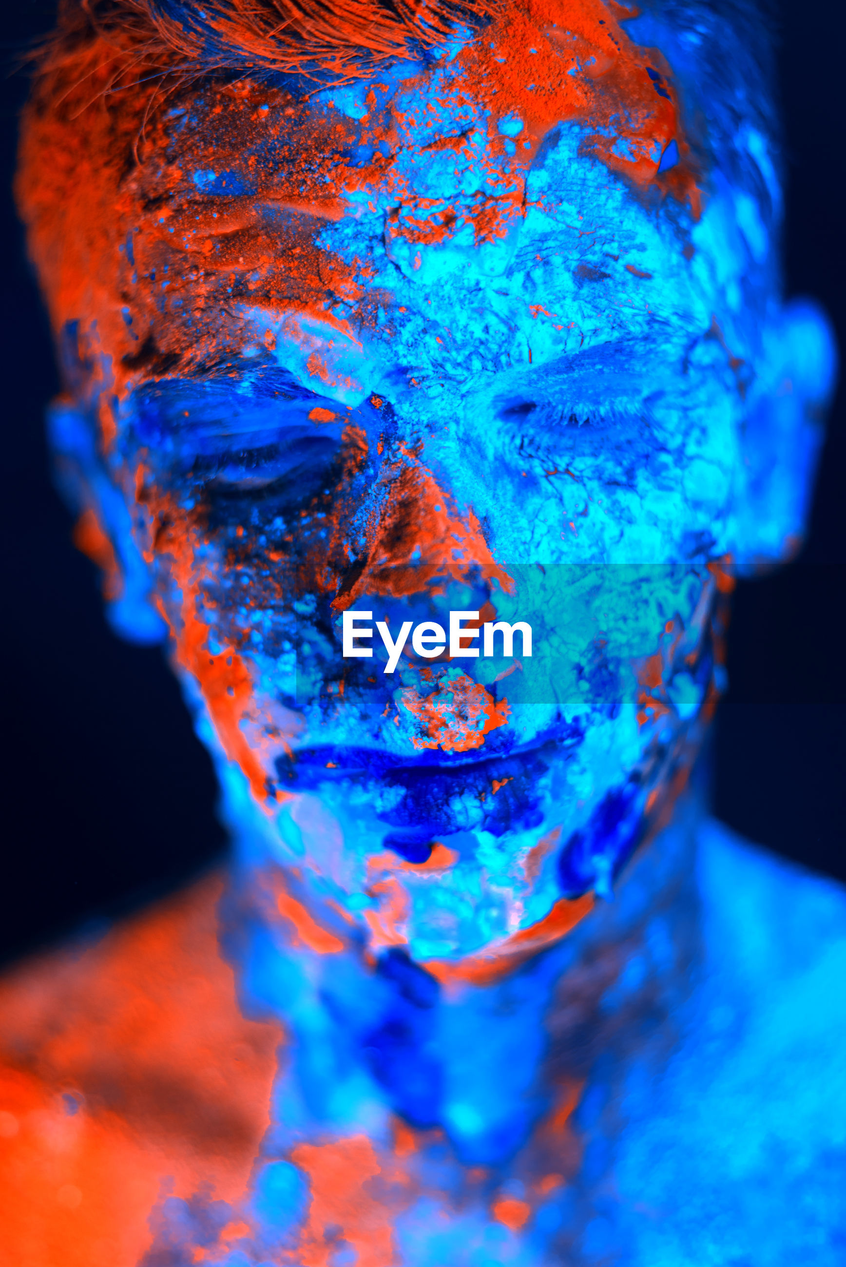 Digital composite image of man with face paint