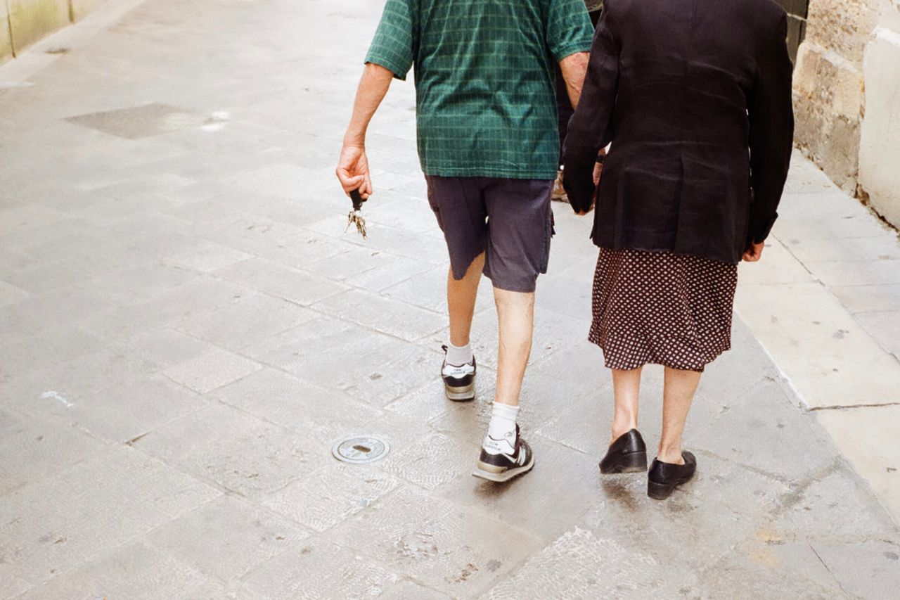 low section, human leg, real people, two people, men, walking, casual clothing, body part, human body part, leisure activity, togetherness, standing, women, lifestyles, day, adult, people, shoe, rear view, friendship, flooring, shorts