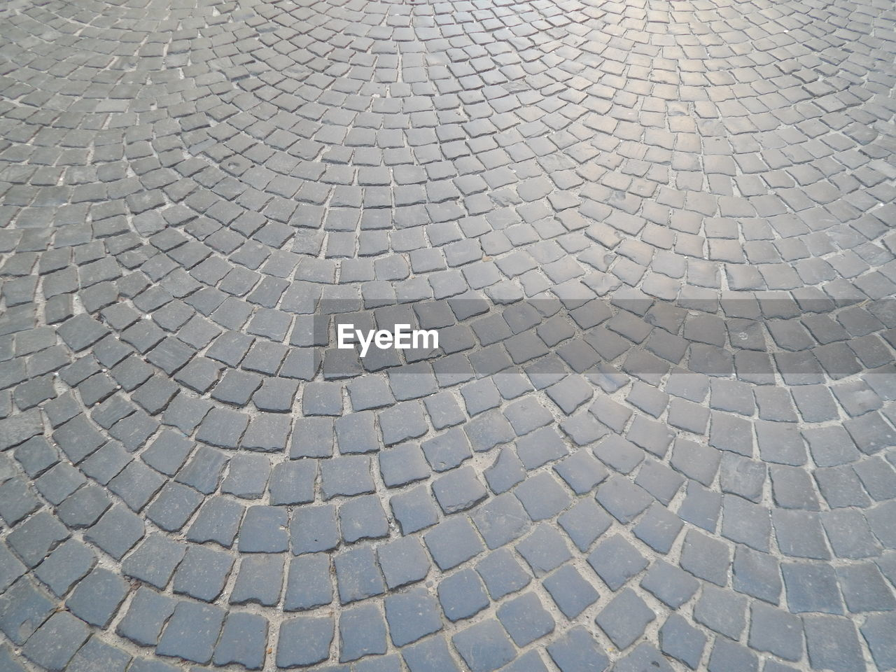 full frame, backgrounds, pattern, street, cobblestone, no people, day, footpath, textured, high angle view, paving stone, outdoors, repetition, stone, design, shape, sunlight, direction, nature, the way forward