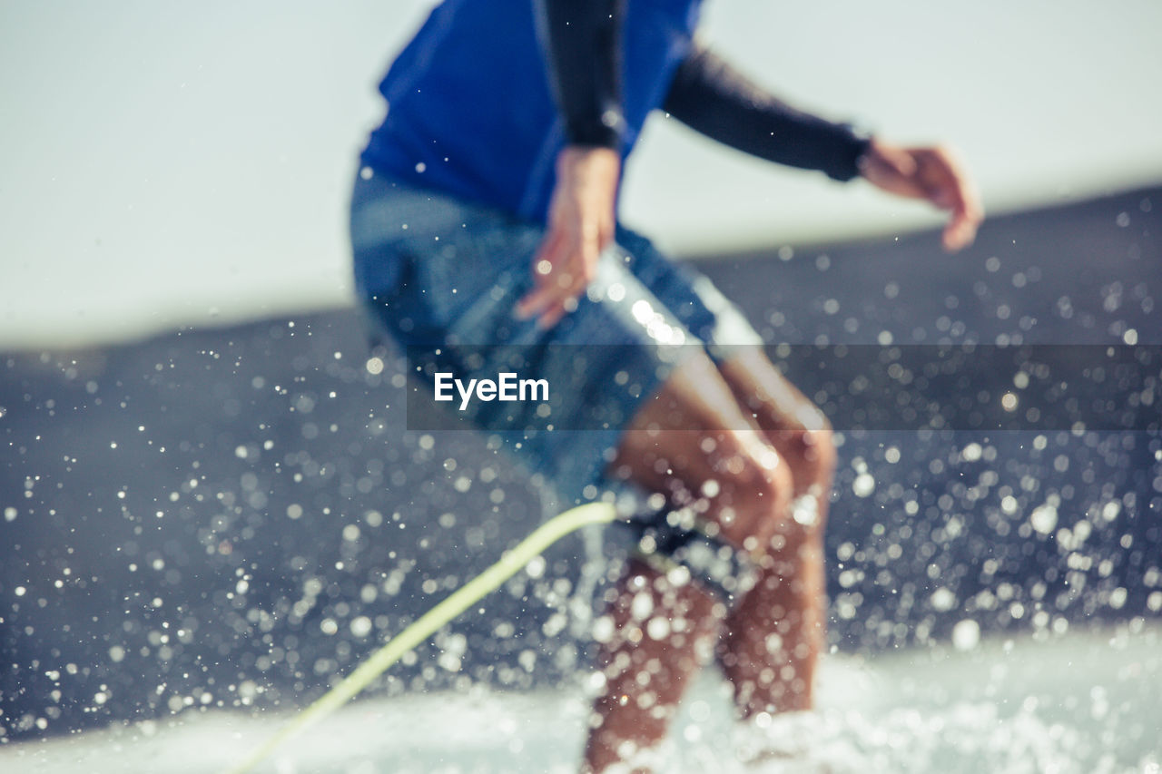 motion, sport, one person, leisure activity, lifestyles, water, nature, activity, real people, men, splashing, focus on foreground, day, determination, athlete, skill, speed, healthy lifestyle, effort