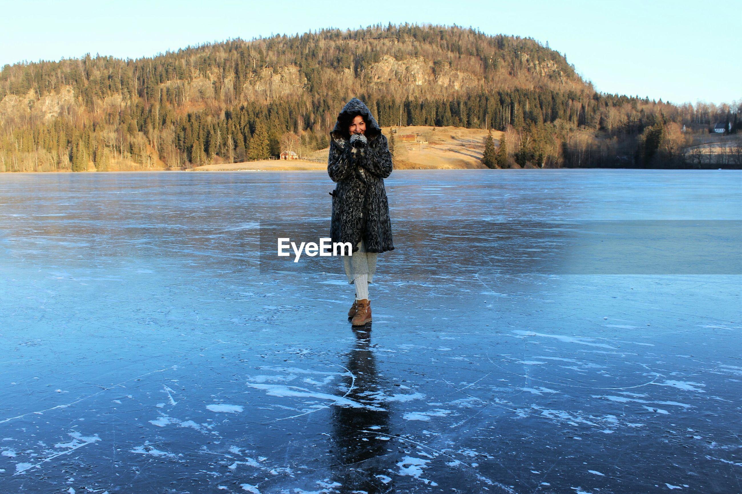View of woman on frozen lake