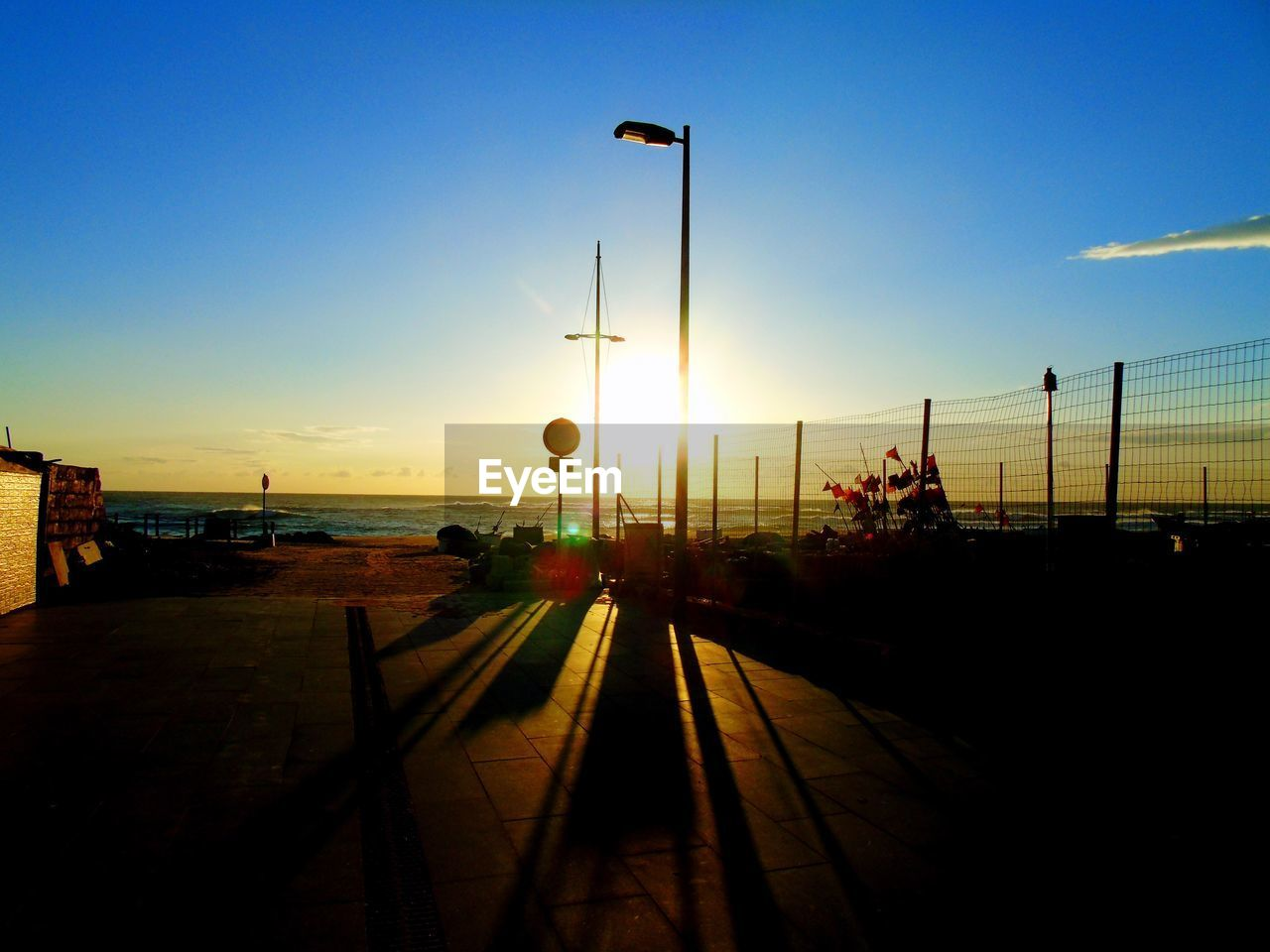 sunset, transportation, silhouette, sky, street light, nature, no people, travel, travel destinations, outdoors, scenics, clear sky, beauty in nature, water, day
