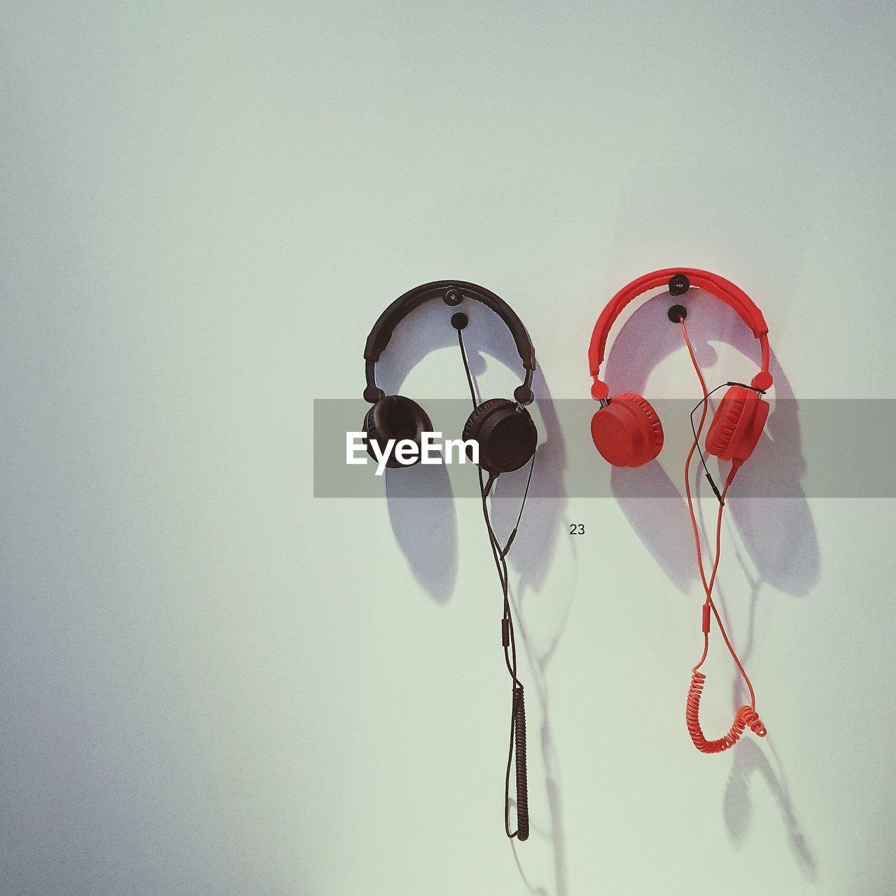 Headphones Hanging On Wall