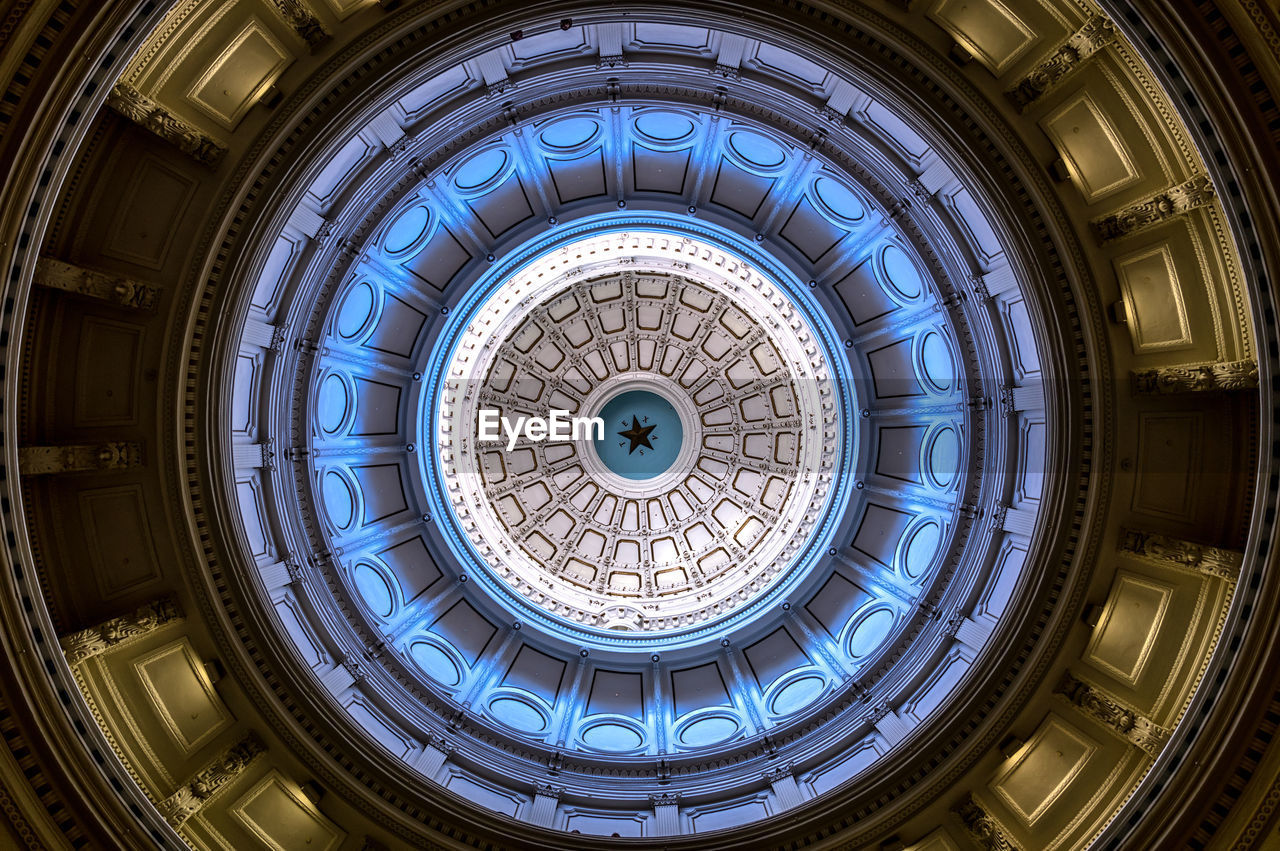 Directly Below Shot Of Illuminated Cupola Of Cathedral