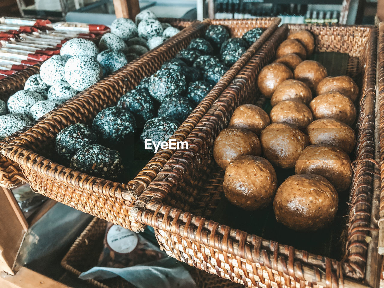 food and drink, basket, food, container, no people, freshness, still life, wicker, high angle view, indoors, brown, bread, close-up, baked, retail, large group of objects, wellbeing, focus on foreground, pattern, for sale, tray, snack
