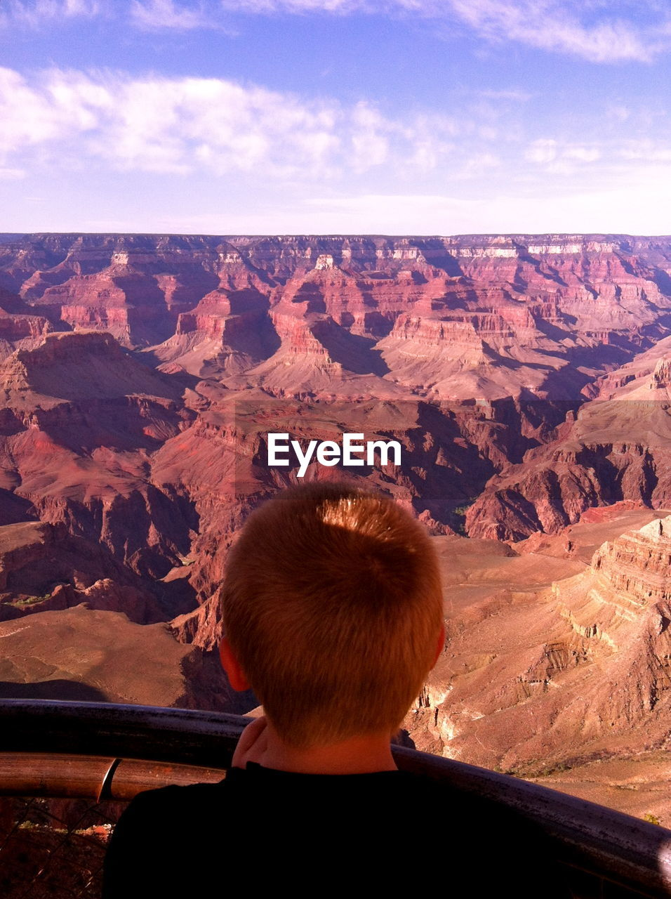 Rear View Of Boy Looking At Rocky Mountains At Grand Canyon National Park