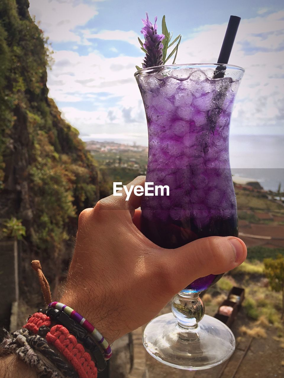 human hand, human body part, real people, one person, focus on foreground, human finger, outdoors, food and drink, refreshment, lifestyles, drinking straw, holding, close-up, drink, day, nature, freshness, water, food, sky, people