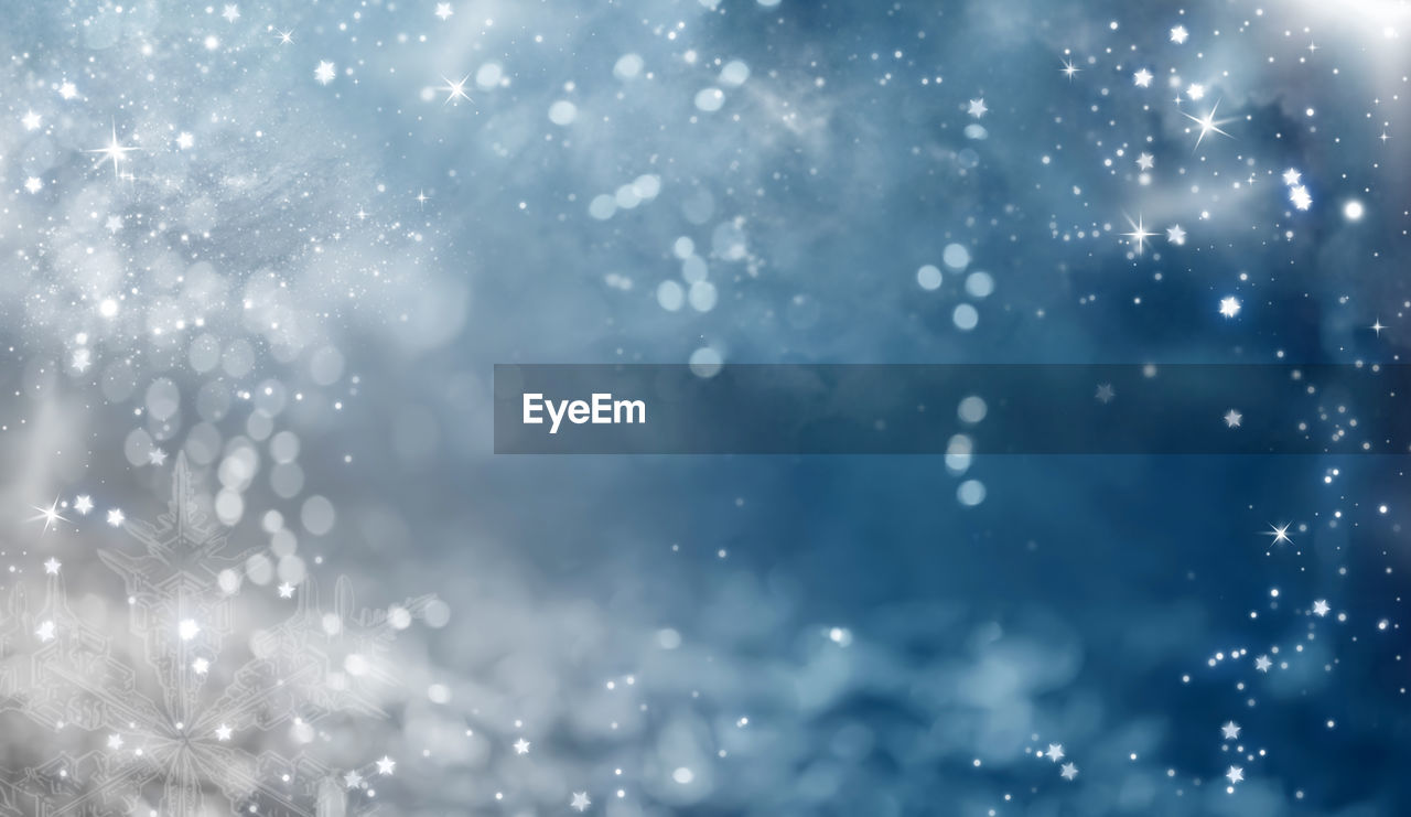 snow, cold temperature, winter, backgrounds, no people, snowflake, christmas, snowing, full frame, nature, holiday, defocused, celebration, sky, illuminated, frozen, extreme weather, shiny, blue, abstract, lens flare, outdoors, blizzard, abstract backgrounds, rain, bright