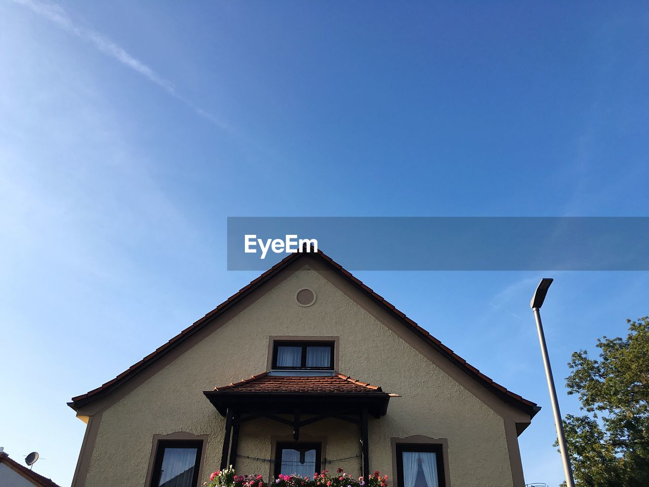 Low Angle View Of House Against Sky During Sunny Day