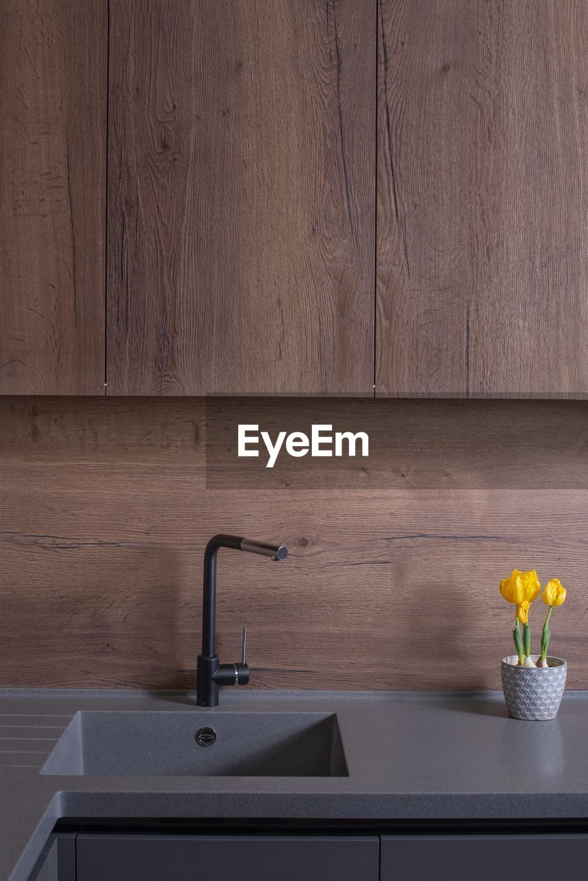 indoors, wood - material, home, no people, faucet, household equipment, still life, home interior, sink, domestic room, simplicity, modern, wall - building feature, domestic bathroom, luxury, table, furniture, bathroom, architecture, hygiene