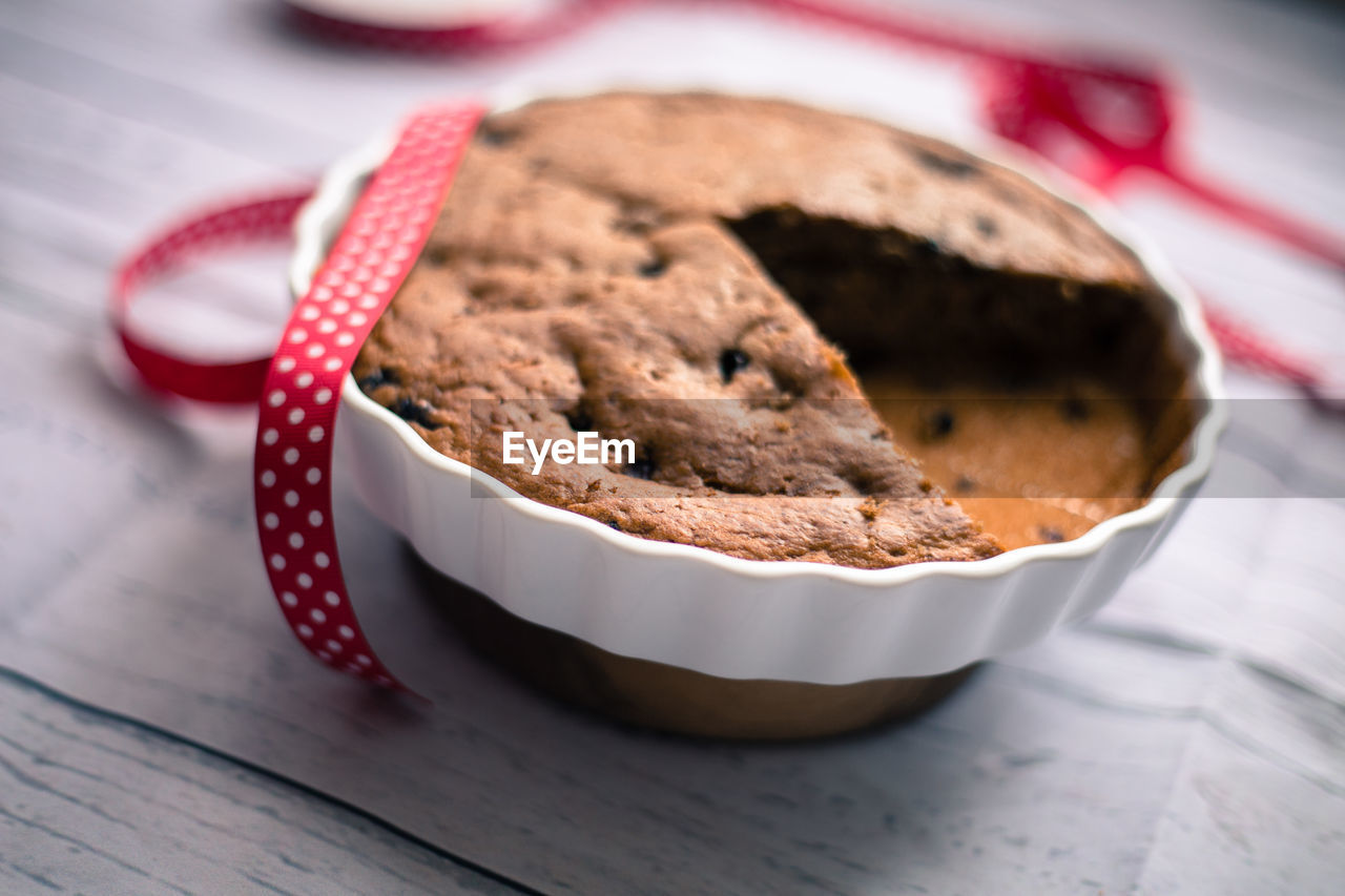 Close-up of cake in bowl on table