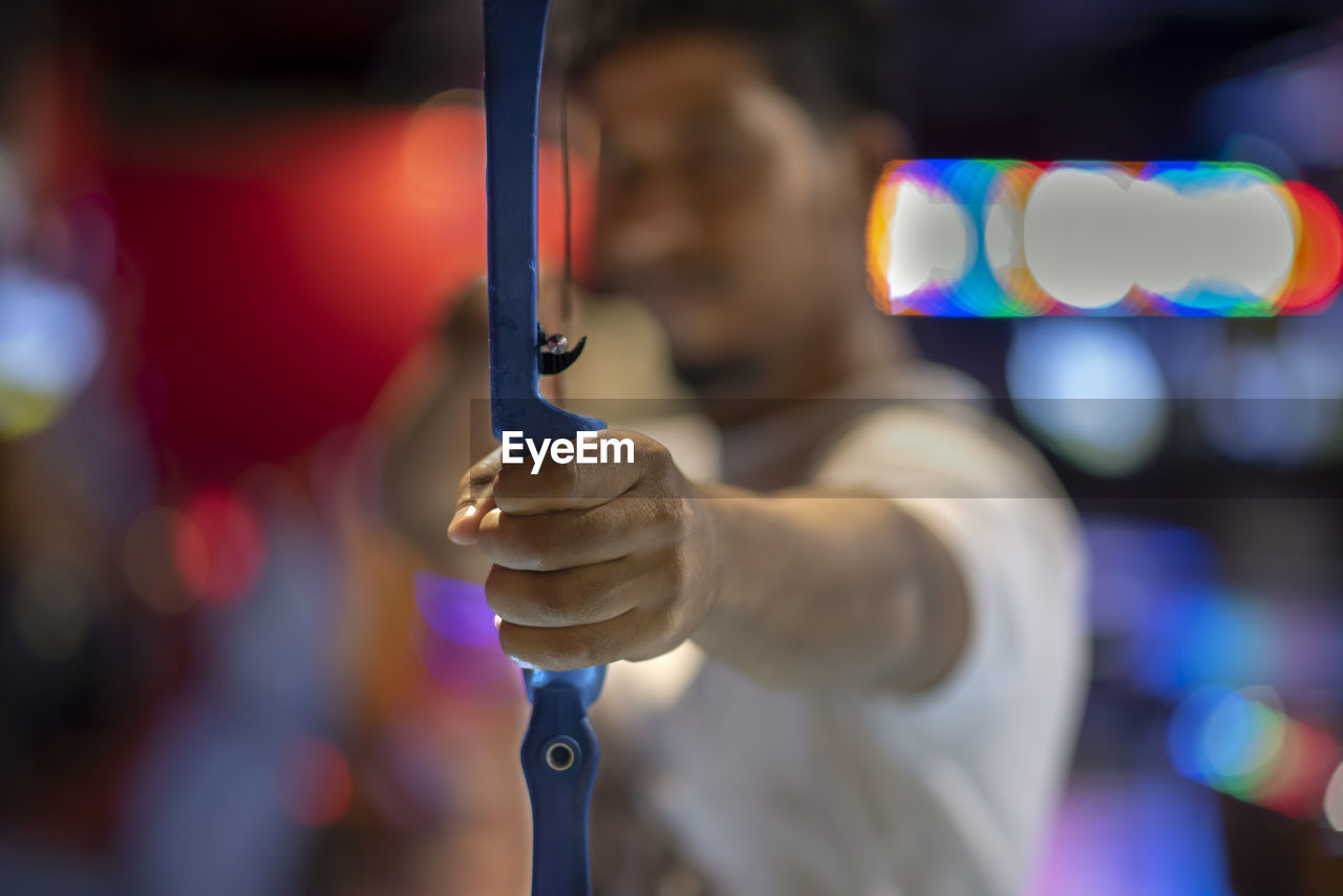 Man Holding Archery Bow