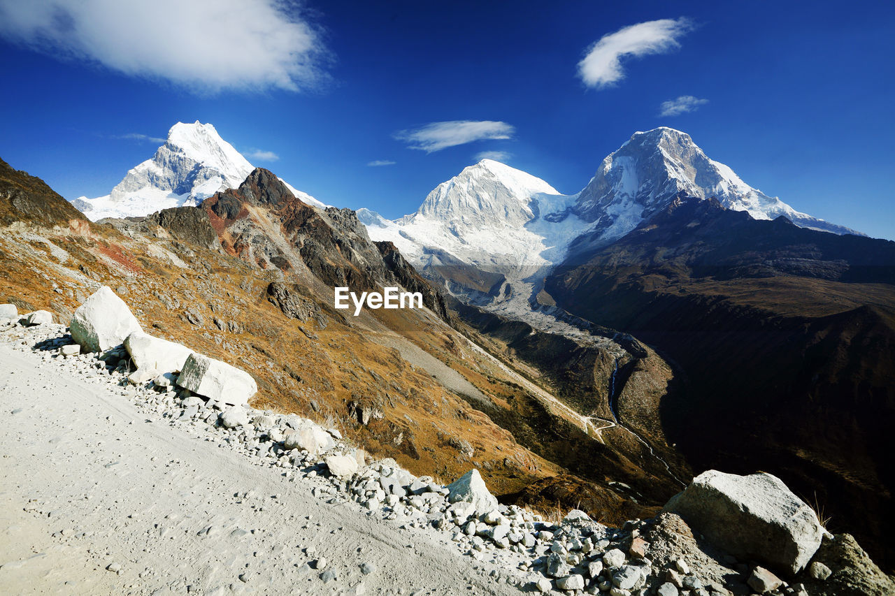 View Of Mountain Peaks With Snow Against Sky
